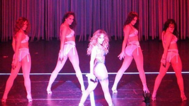 Janick (far right,) dances alongside Jennifer Lopez on the AXIS theatre stage at Planet Hollywood.