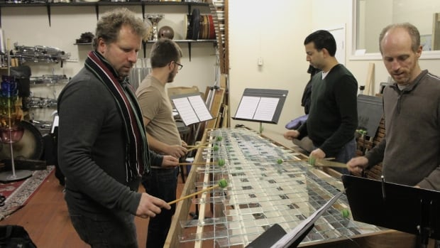 The Fringe Percussion Quartet practices on a glass-key marimba for tonight's concert, City of Water, Sea of Glass.