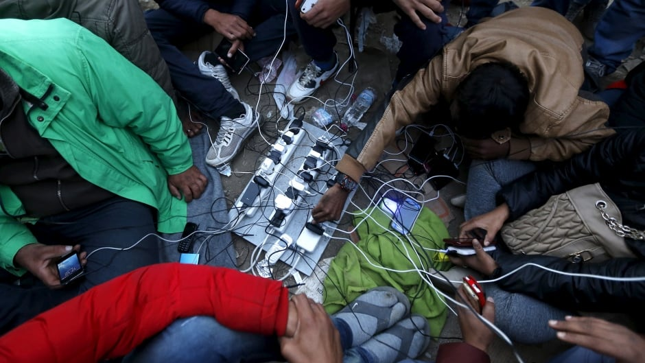 Stranded migrants charge their phones at the Greek-Macedonian border.