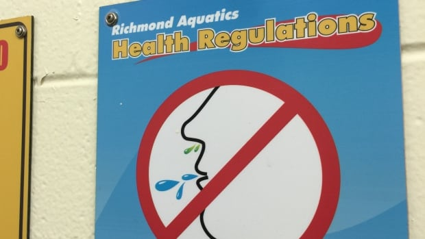 No spitting signs similar to this one are posted a Minoru Aquatic Centre in Richmond.