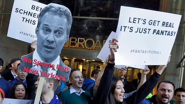 Fantasy sports fans demonstrate outside the offices of New York state Attorney General Eric Schneiderman who has said these websites must stop taking money from New York residents as they amount to illegal gambling.