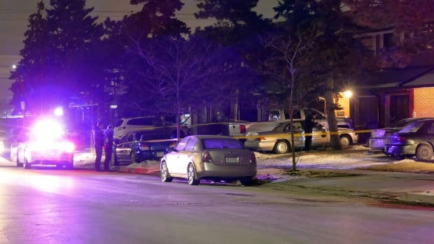 Peel Regional Police at the scene of a shooting on Netherbrae Road in Mississauga, Ont. late Friday night.