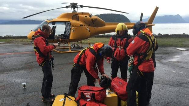 Member of B.C.'s North Shore rescue prepare to search Howe Sound area for a missing snowboarder. The man's body was found Saturday.