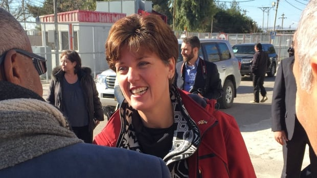 International Development Minister Marie-Claude Bibeau is greeted by Jordanian officials in the town of Ramtha, close to where some of the 680,0000 Syrians displaced by war are living.