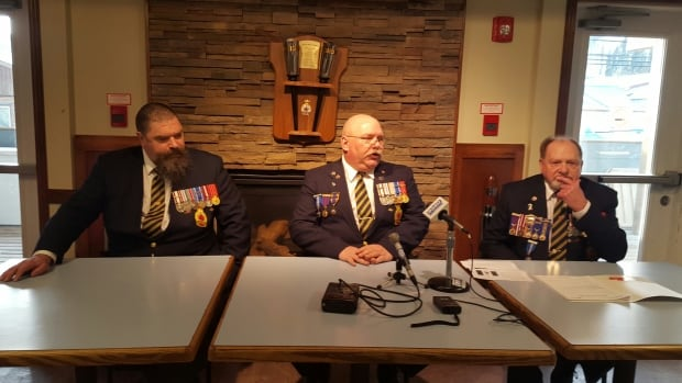Darcy Grossinger, Joe Mewett and Red Grossinger of the Whitehorse Royal Canadian Legion announce a motto contest for Yukon.