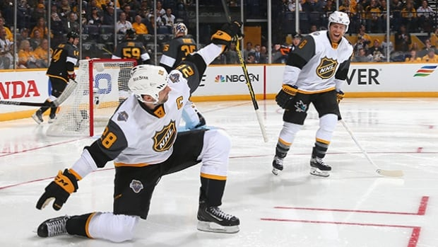 John Scott celebrates after scoring a goal 47 seconds into the all-star game. He ended up scoring twice and his team won 9-6 to advance to the final.