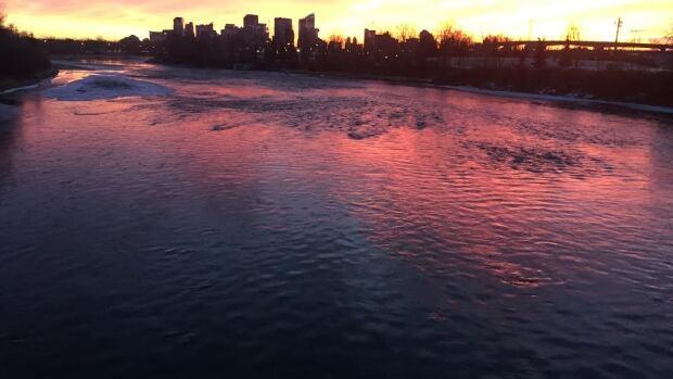 The sun rises in a burst of colour in Calgary.