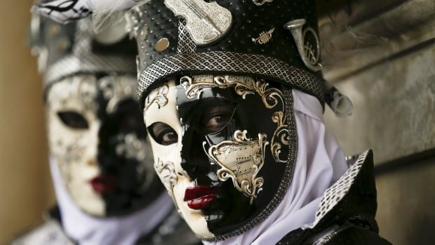 Masked revellers pose during the Venice carnival in St. Mark's Square on Jan. 30.