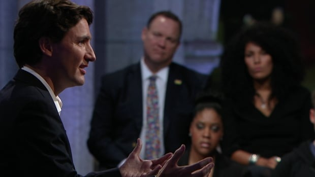Prime Minister Justin Trudeau answers questions during his town hall in the foyer of the House of Commons after speaking with ten Canadians, face to face in his office.
