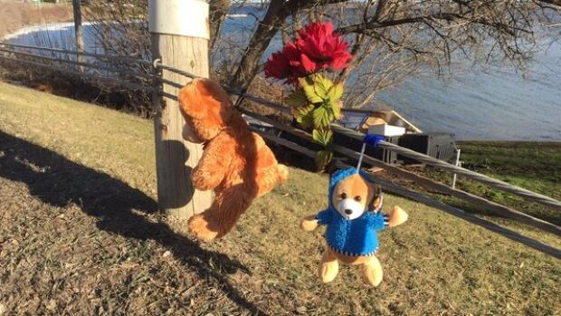 Teddy bears and flowers have been put up at the site of a fatal crash on County Road 2 east of Bradley Crescent in Augusta Township.