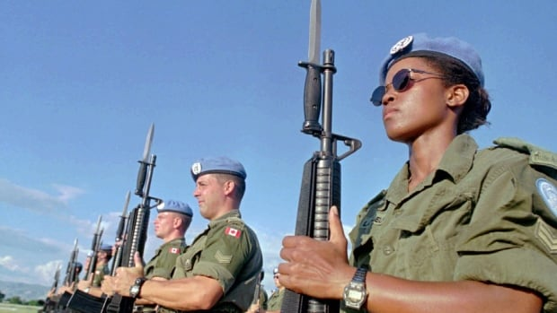 Canadian Peacekeepers prepare for a parade at Maple Leaf Camp in Port-au-Prince on Nov.28,1997. About 100 Canadian soldiers practice for the official conclusion of their part in a United Nations mission in Haiti.