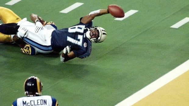 Titans wide receiver Kevin Dyson stretches for the end zone but falls short as he is tackled by Rams linebacker Mike Jones as time runs out in Super Bowl XXXIV at the Georgia Dome in Atlanta. The Rams defeated the Tennessee Titans 23-16. The drive, which began at the Tennessee 12-yard line, is one of the most dramatic in Super Bowl history.