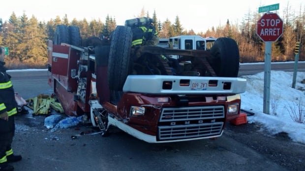 A Blacks Harbour fire truck overturned on its way to a house fire on Tuesday morning. A volunteer firefighter was taken to hospital where he was treated and released.