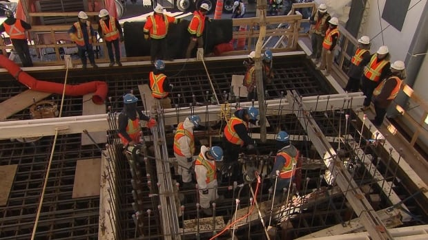 Crews pour concrete into one of 38 footings of the new Champlain Bridge.
