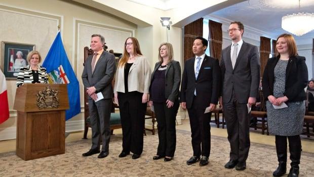 Premier Rachel Notley looks on as Richard Feehan (far left) Christina Gray, Stephanie McLean, Richardo Miranda, Marlin Schmidt and Brandy Payne were sworn in to the Alberta cabinet Tuesday.