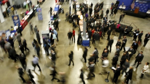 Job seekers are shown at a January job fair in the U.S., where unemployment has fallen to levels economists consider to be full employment.