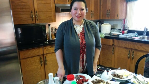 Kaye Banez, here in her home, teaches a Filipino cooking class at Langara called Filipino Fiesta.