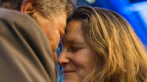 International Trade Minister Chrystia Freeland performs hongi (the traditional Maori welcome) with a Maori elder at the signing of the Trans-Pacific Partnership Agreement in Auckland, New Zealand, Thursday.