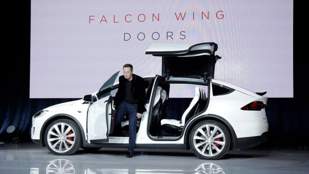 Elon Musk, CEO of Tesla Motors, introduces the Model X at the company's headquarters on Sept. 29, 2015, in Fremont, Calif.