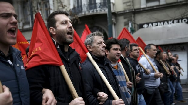 Protesters from the Communist-affiliated trade union PAME march during a 24-hour general strike against planned pension reforms in central Athens, Greece on Thursday.