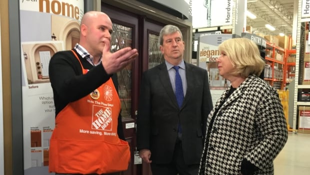 Environment Minister Glen Murray and Deputy Premier Deb Matthews tour a Home Depot as part of an announcement about a new program for improving energy efficiency.