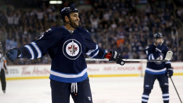 Winnipeg Jets' Dustin Byfuglien signed a five-year contract with team on Monday.