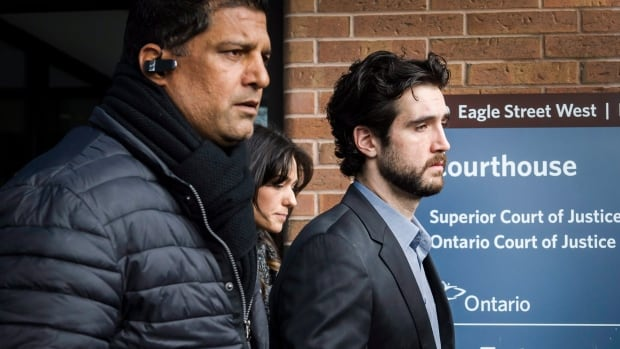 Marco Muzzo (right) leaves the Newmarket courthouse surrounded by family on Thursday, February 4, 2016.