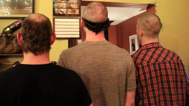 'This is what happens when there is no hairdresser in town,' says Nicky Richards. 'The guys have to revert to cutting their own hair.' Landon Kozma (left), Simon Corey (centre) and Jason Balski (right) recently turned the clippers on each other in Norman Wells, N.W.T.
