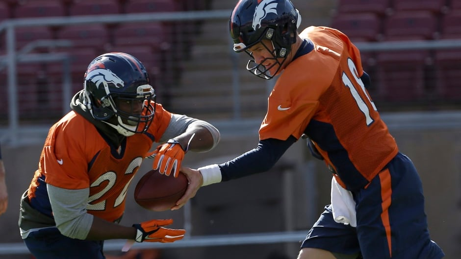 Denver Broncos quarterback Peyton Manning (18) hands off to running back C.J. Anderson (22) during an NFL football practice in Stanford, Calif., on Thursday, Feb. 4, 2016.