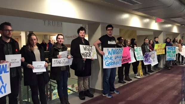 Students at Mount Allison University held a silent protest Friday morning outside the Board of Regents meeting asking the university to continue funding the women's and gender studies program which they believe is in jeopardy.