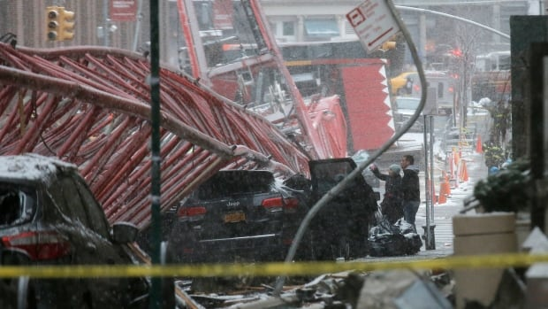 Emergency crews survey a massive construction crane collapse in Lower Manhattan on Feb. 5.