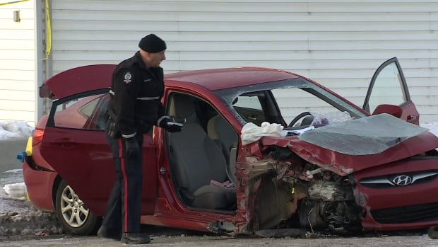 Police shut down a second of 112th Avenue near 50th Street Friday morning after a car crashed into the side of a house.