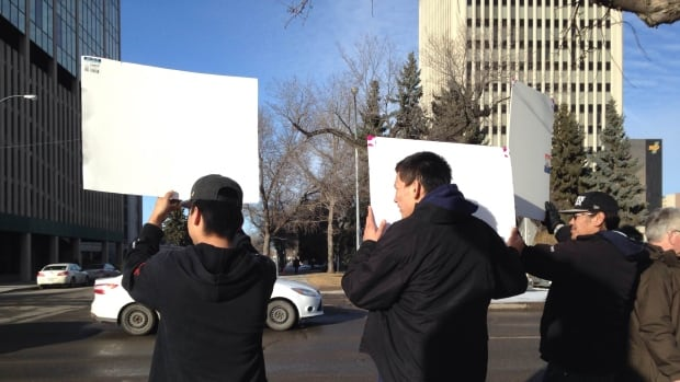 Supporters hold signs and balloons outside the Queen's Bench Courthouse in Regina while the jury deliberates in the trial of Kevin and Tammy Goforth.