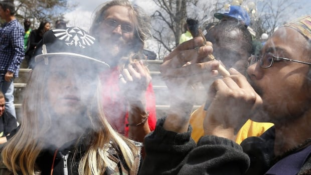 Colorado party-goers smoke during the annual 4/20 marijuana festival. Tax revenue from marijuana sales in the state hit $135 million US in 2015, according to a recent report.