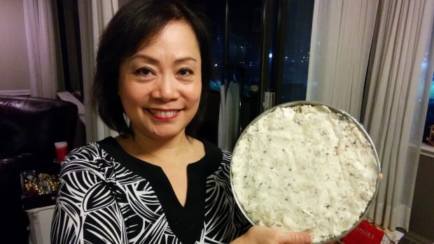 Elaine Chau's mother Angela Ip taught her about traditional Lunar New Year food. Here she is holding a daikon radish cake before steaming it.