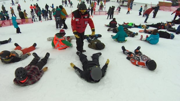 After making snow angels, members of the Canadian Ski Patrol helped up all the participants that helped out with the record attempt.