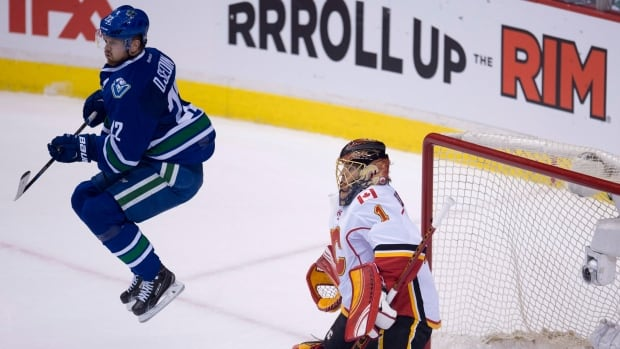 Even a flying Sedin, Daniel in this case, wasn't enough to distract Jonas Hiller and the Calgary Flames from taking a 4-1 decision at Rogers Arena in Vancouver.