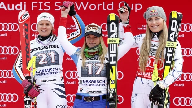 Switzerland's Lara Gut, centrE, winner of the super-G race, celebrates on the podium with second-placed Germany's Viktoria Rebensburg, left, and third-placed American Lindsey Vonn, in Garmisch-Partenkirchen, Germany, Sunday, Feb. 7, 2016.