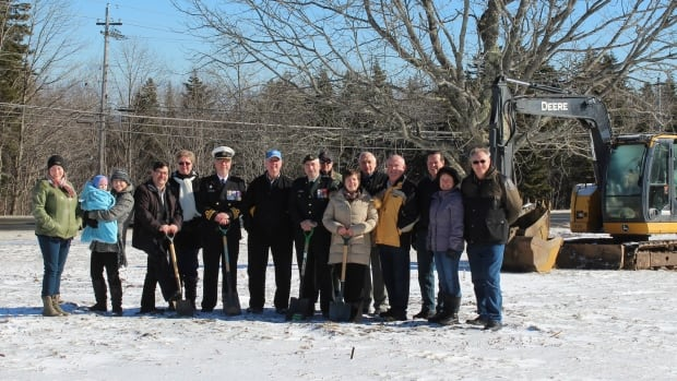 Board members of the Greater Hammonds Plains-Lucasville Cenotaph committee, residents and private donor Vernon Kynock pose for a photo as construction of the Uplands Park cenotaph began Saturday.
