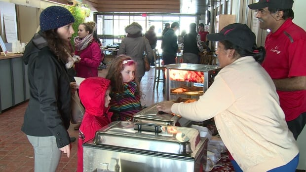 Shena Mathew and her husband Sunil sell Indian food at Charlottetown's newest farmers market.