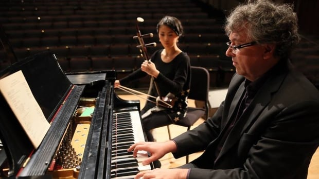 Nicole Gu Li (left) and Corey Hamm play contemporary music on the erhu and piano, and plan to take their duo on tour in China, in May.