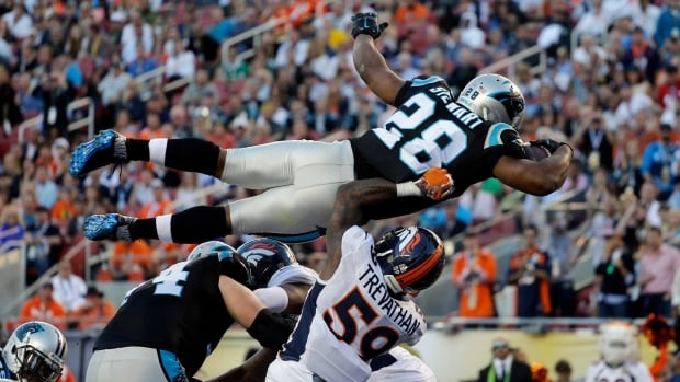 Carolina Panthers' Jonathan Stewart (28) scores his team's first touchdown during the first half of the NFL Super Bowl 50 football game against the Denver Broncos.
