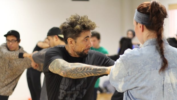 Calgary funk and hip hop dancers get a lesson from popping and locking pioneer, Suga Pop.