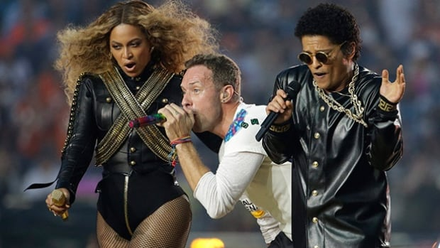 Beyoncé, Coldplay singer Chris Martin and Bruno Mars perform during halftime of Super Bowl 50 on Sunday in Santa Clara, Calif.