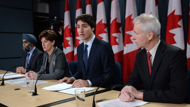 From left: Defence Minister Harjit Sajjan, International Development Minister Marie-Claude Bibeau, Prime Minister Justin Trudeau and Foreign Affairs Minister Stephane Dion announced changes to Canada's contribution to the war against the Islamic State of Iraq and Syria in Ottawa on Monday.