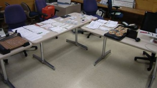 Pay cheques, financial statements, and fake SIN cards are among the items seized by Toronto police from this so-called 'fraud lab.'