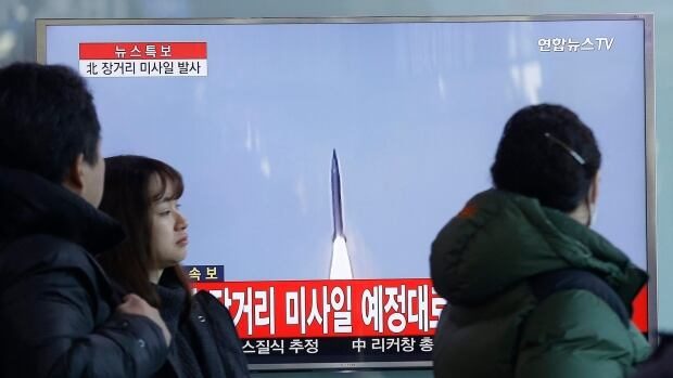 South Koreans in Seoul watch a TV news program with footage about North Korea's rocket launch. North Korea on Sunday defied international warnings and launched a long-range rocket that the United Nations and others call a cover for a banned test of technology for a missile that could strike the U.S. mainland.