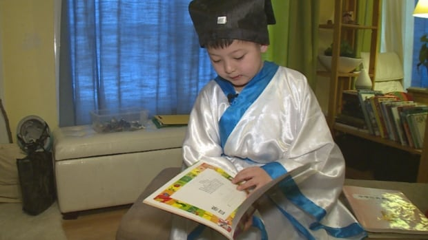 Ting Bai Liu, 8, has been taught by his parents to read Chinese poetry.