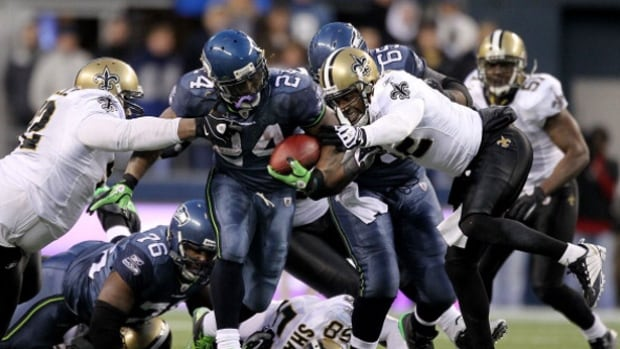Marshawn Lynch (24), seen here breaking tackles during one of his most memorable moments in 2011, announced his retirement Sunday.