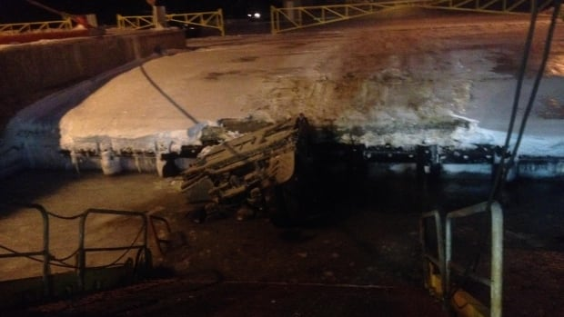 Dean Snow's dump truck sunk between the wharf and the ferry ramp Monday evening.